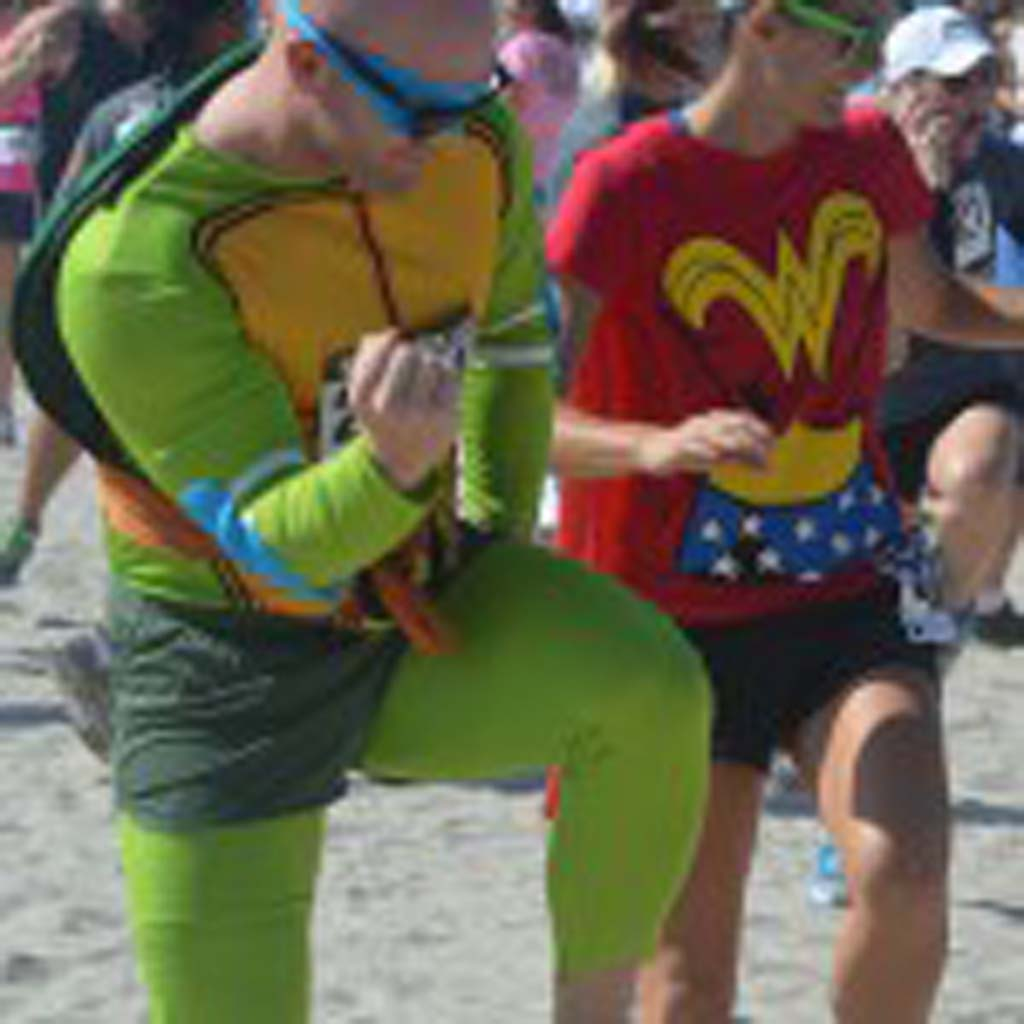 John Bradley, as a Teenage Mutant Ninja Turtle, takes part in some Zumba before the start of the race. Photo by Tony Cagala