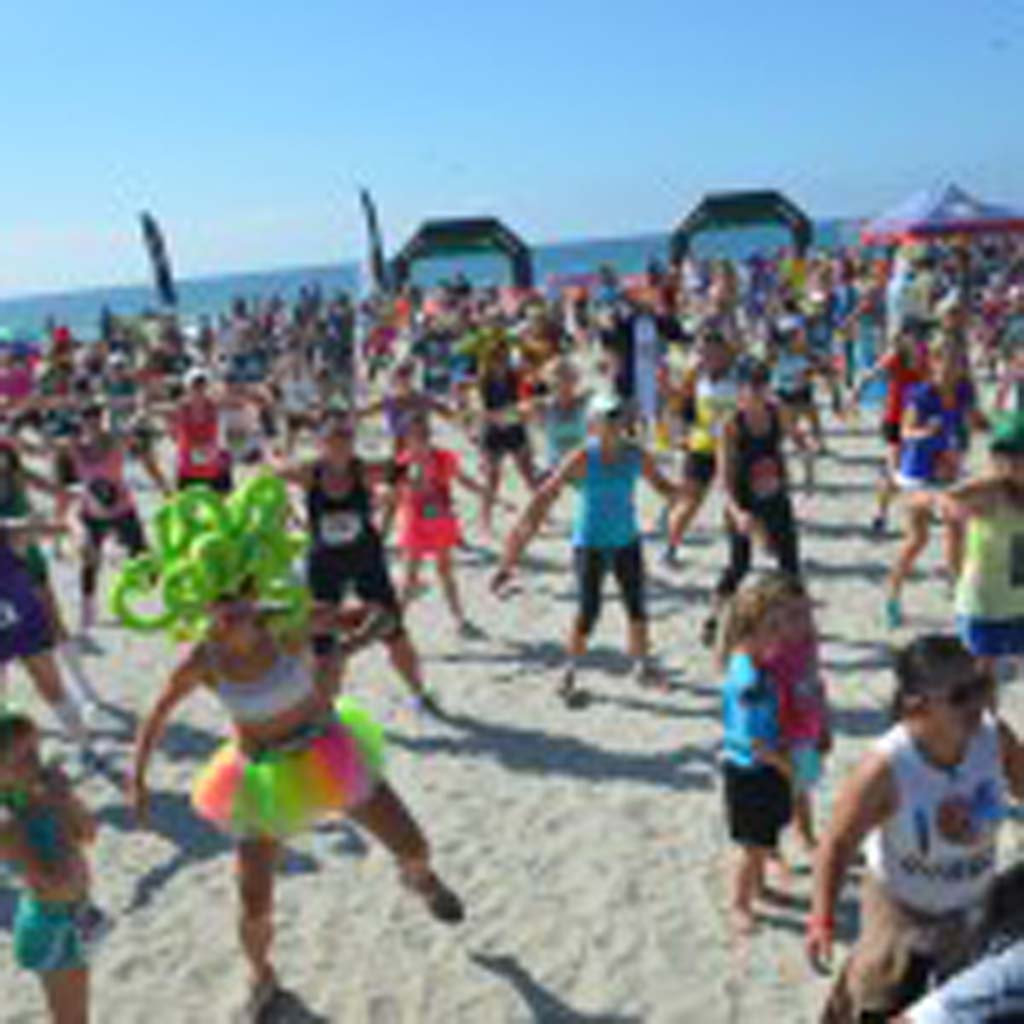 A large crowd takes part in a Zumba event prior to the start of the second annual Surfing Madonna 5K/10K race on Saturday. Photo by Tony Cagala
