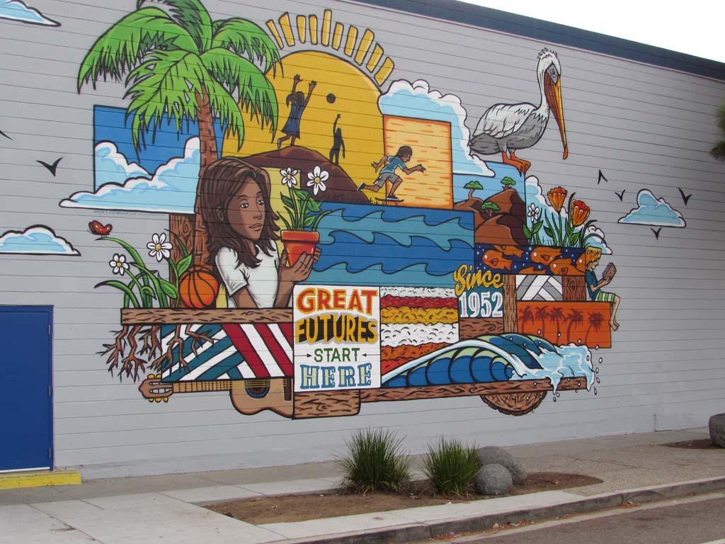 Artist Skye Walker completes a new mural on the side of the Boys & Girls Club in Carlsbad. Photo by Ellen Wright