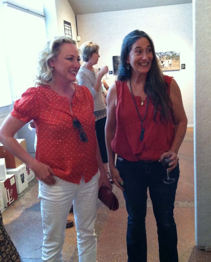 """Actress Virginia Madsen (left), who starred in the 2004 film """"Sideways,"""" chats with photographer Merie Weismiller Wallace, who took the stills during the filming of the movie. They met Oct. 4 at the Elverhoj Museum of History and Art in Solvang where a collection of Wallace's photos are on exhibit through Nov. 2. The exhibit marks the 10th anniversary of """"Sideways,"""" which has attracted many visitors to the Santa Ynez Valley where the movie was filmed."""