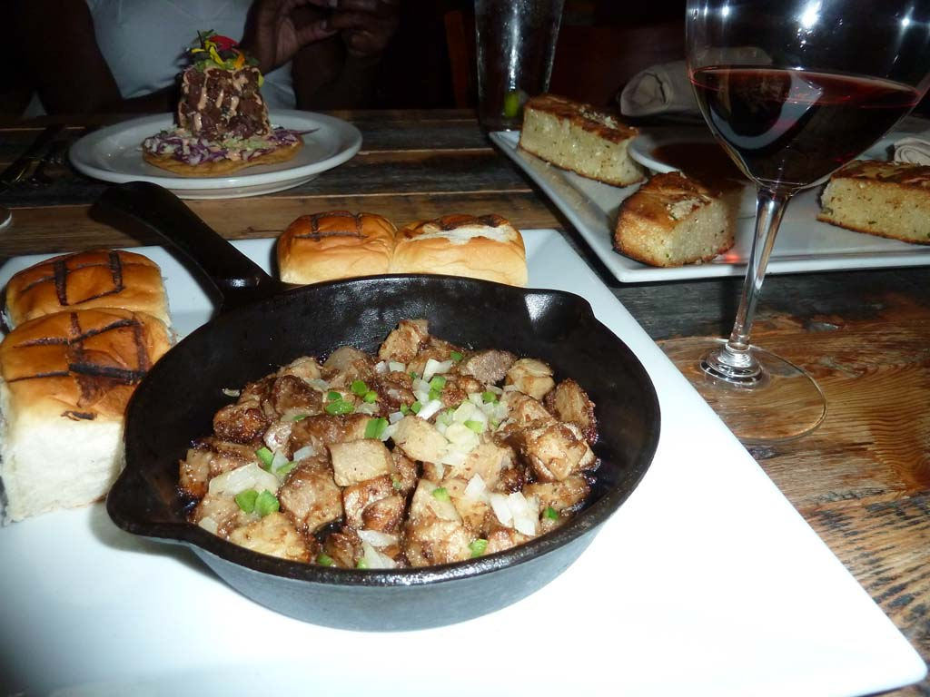 Sizzling Sisig is a small plate at Sublime Del Mar with pork collar and shoulder in a skillet,  onion and jalapeno, served with Hawaiian sweet rolls.  Photos by Frank Mangio