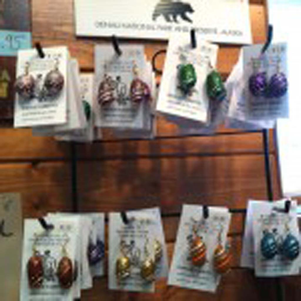 These earrings, made of moose poop, are a favorite of tourists looking to spend their souvenir dollars in Talkeetna, Alaska, population 800-something. The downtown area has been named to the National Register of Historic Places. To make earrings, the droppings are dried, heavily shellacked, then decorated.