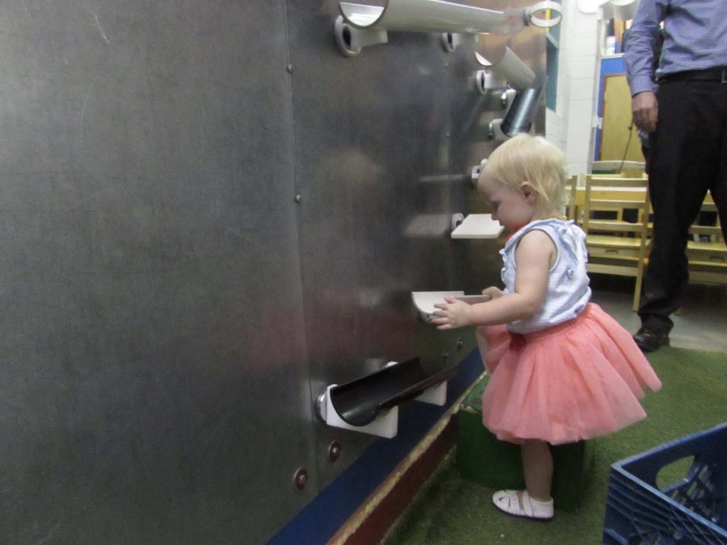 Aubriana Anglea plays with the magnetic wall at The San Diego Children's Museum. Her mother Tammy said they visit at least once a week. Photo by Ellen Wright