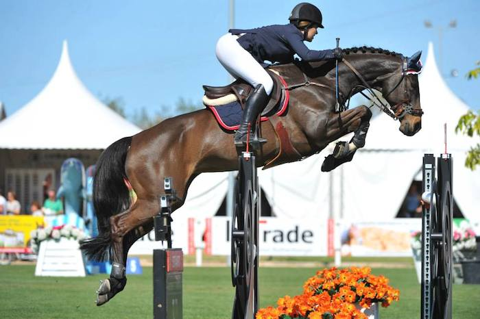 Lauren Hester, here competing on Warinde B, relocated from Rancho Santa Fe to the tiny town of Baarlo in the Netherlands in 2013 and has just returned. Photos by Herve Bonard