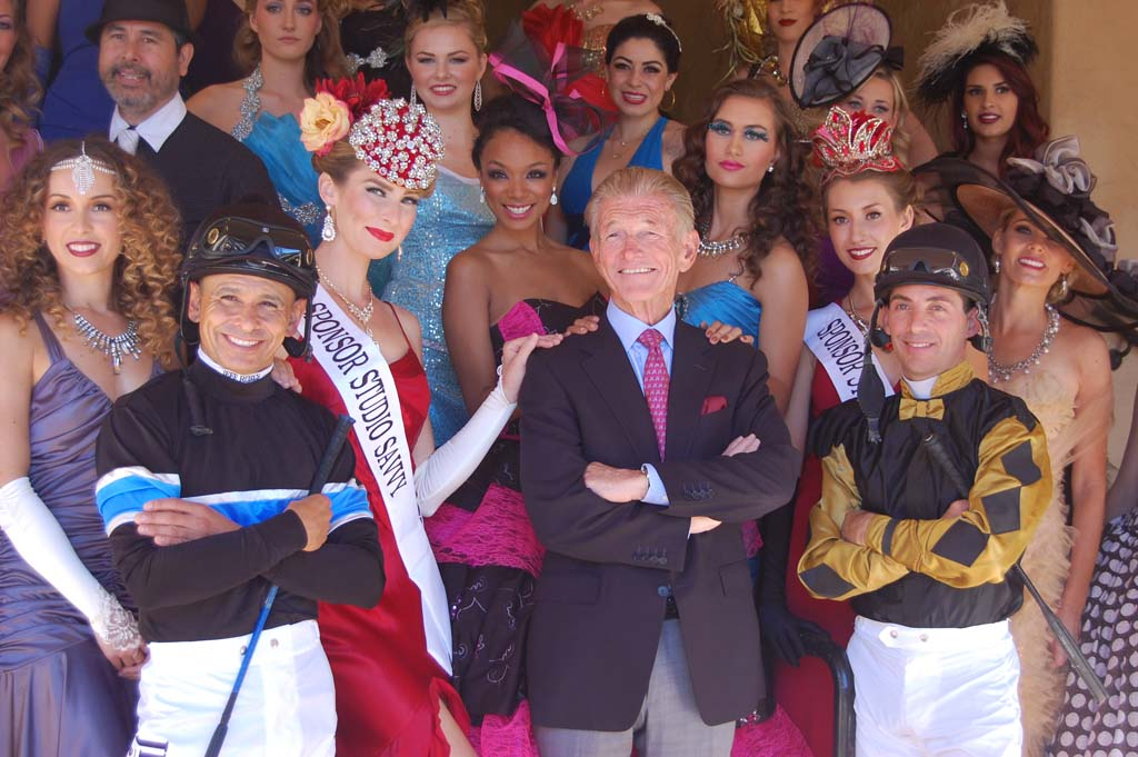 Joe Harper, center, president and CEO of the Del Mar Thoroughbred Club, poses with fashion show contestants and jockeys Mike Smith, left, and Aaron Gryder before the start of the inaugural Bing Crosby Season. Photo by Bianca Kaplanek