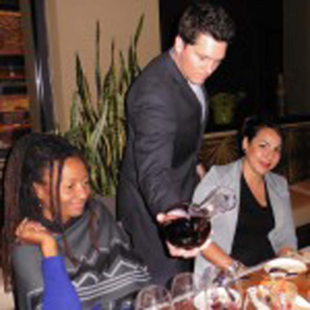 Marina Kitchen's Top Sommelier winner Josh Orr pours a red wine at a recent Blind Tasting seminar. Photo by Frank Mangio