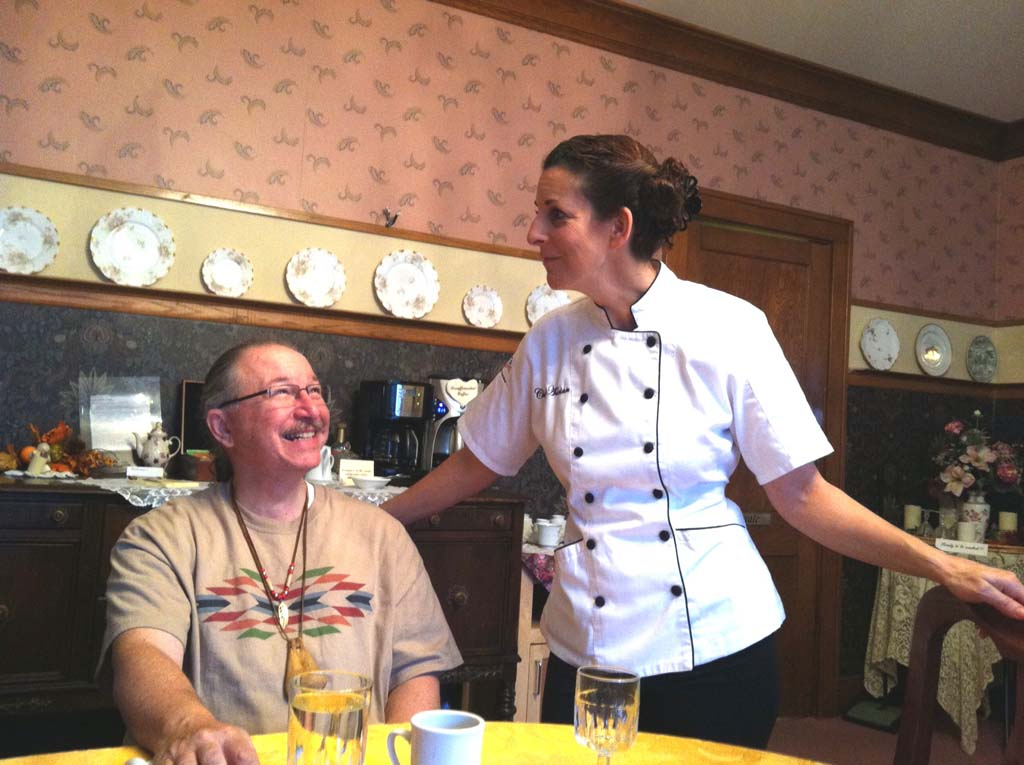 "Mark Ransom of Anchorage shares a joke with Adrian Potter, co-owner and chef at Abilene's Victorian Inn. Potter loves to cook and happily caters to those with special dietary needs. The nearly 6,800-square-foot, three-story inn was built in 1887 by a town doctor and has been restored to its 1920s splendor. The wide, welcoming front porch and large parlors are perfect gathering places. Discounts available for renting entire house. Visit  HYPERLINK ""http://www.abilenesvictorianinn.com"" www.abilenesvictorianinn.com or call 888-807-7774. (Photo by E'Louise Ondash)"