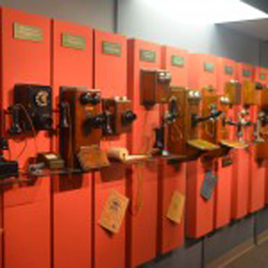 A bank of phones from days-gone-by lines the wall at the Museum of Independent Telephony in Abilene, Kansas. The museum tells the story of non-Bell telephone companies and the fiercely loyal employees who dug the holes, raised the poles and worked the switchboards. Photo by Jerry Ondash
