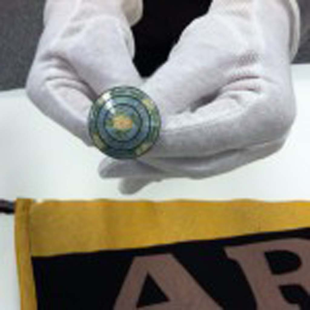 """This 12-inch-long hat pin with enamel top was given to Ruby Norman Lucier by Dwight Eisenhower during the early 1900s when they had a relationship described as """"close without commitment."""" Both grew up in Abilene, Kan. The pennant, from the United States Military Academy at West Point, also was a gift from Ike to Ruby. Both are part of a collection of artifacts at the Eisenhower Presidential Library, Museum and Boyhood Home in Abilene. (Photo by Jerry Ondash)"""