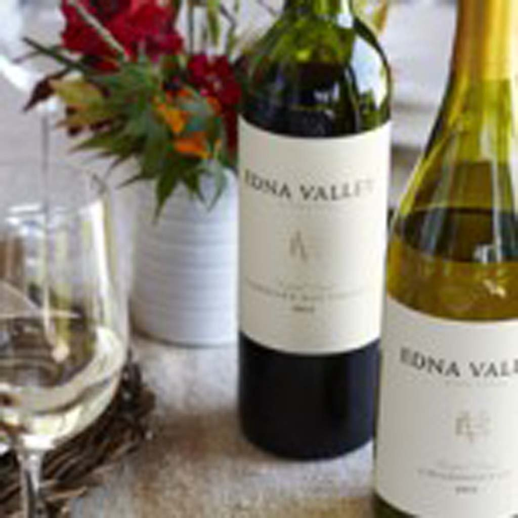 Pinot Noir is the choice for a Thanksgivng dinner wine that pairs well with almost any entrée, shown with a Chardonnay, both from Edna Valley. Photo courtesy Edna Valley Winery