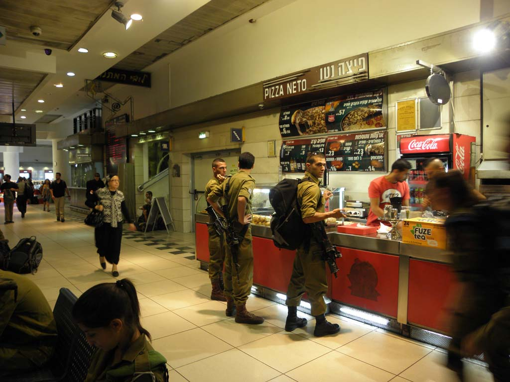 It's not unusual to see well armed soldiers everywhere in Israel. Here they order pizza at a shop in Jerusalem's busy central bus station. All photos by Frank and Janis Galef