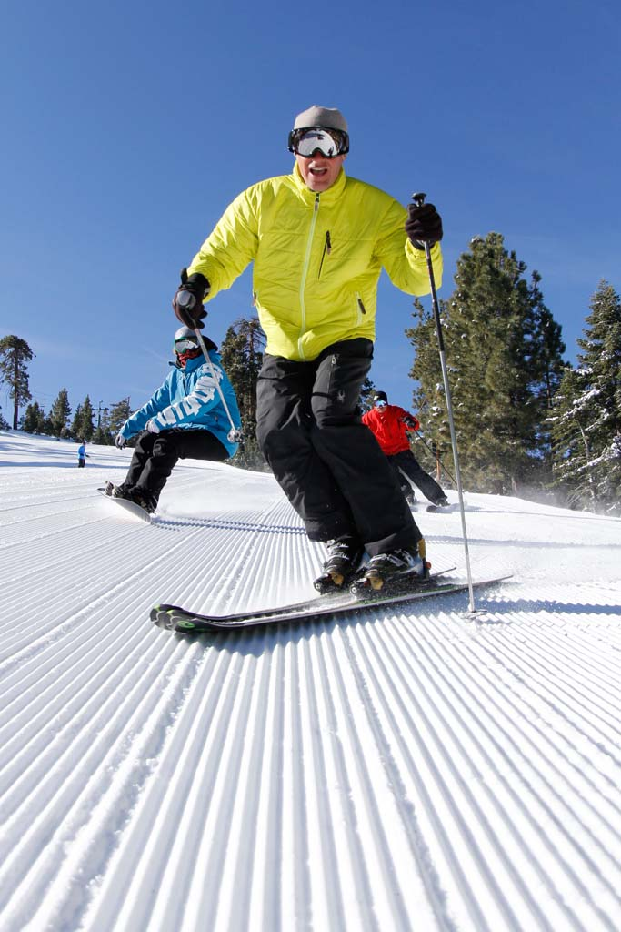 Great skiing and lodging at a good price is only two hours away from North County through Big Bear Mountain Resorts. Package deals offer lift tickets good at both Snow Summit and Bear Mountain's more than 435 developed acres, 26 lifts, four high-speed chairs, and 1,800 vertical feet. (Courtesy photo.)
