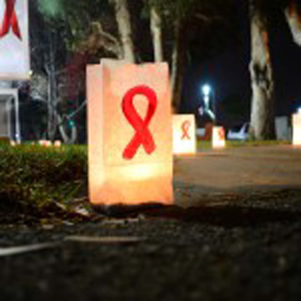 Candles light the way towards the entrance of Pilgrim United Church of Christ in Carlsbad on Monday, celebrating World AIDS Day.
