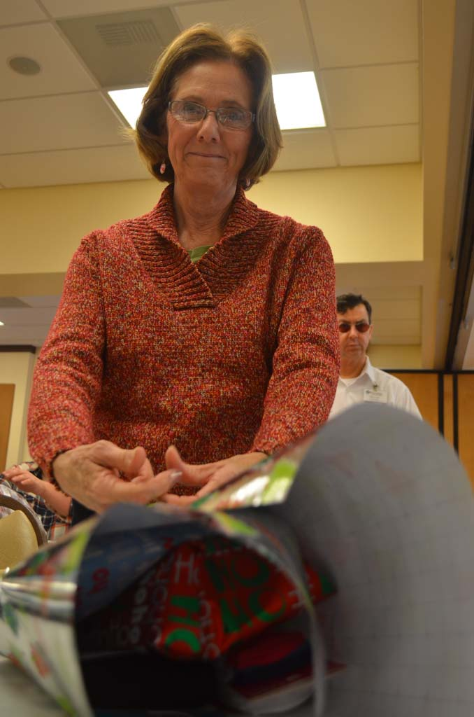 Nancy Angelo of Vista wraps a gift that will be going to a senior in need. Photo by Tony Cagala