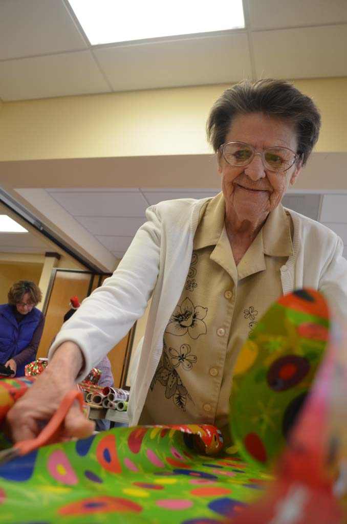 Jackie Hartley of San Marcos helps to wrap gifts that will go to needy seniors. Photo by Tony Cagala
