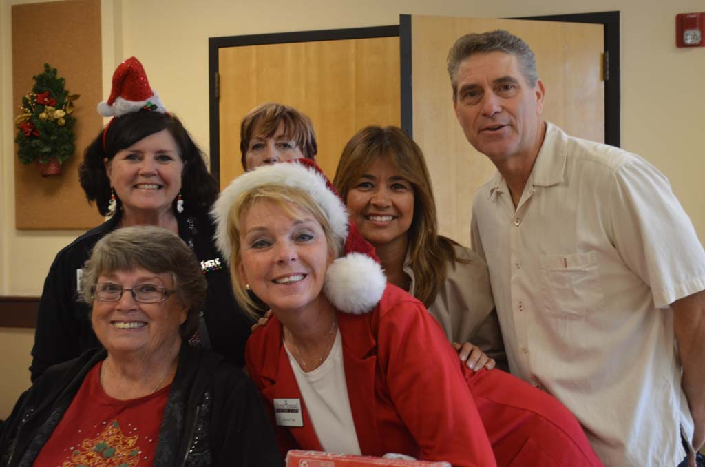Paul Dziuban, far right, with volunteers on Tuesday help wrap gifts at the San Marcos Senior Center. The gifts will be distributed to needy seniors through a program called Be a Santa to a Senior. Photo by Tony Cagala