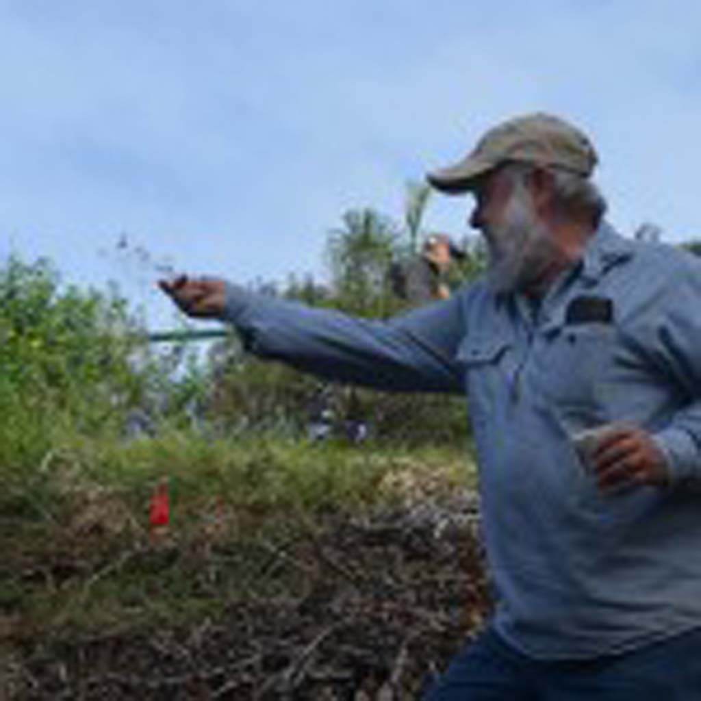 Mark Wisniewski of the Cottonwood Creek Conservancy broadcasts native seeds onto the slopes of Cottonwood Creek on Saturday. Photo by Tony Cagala