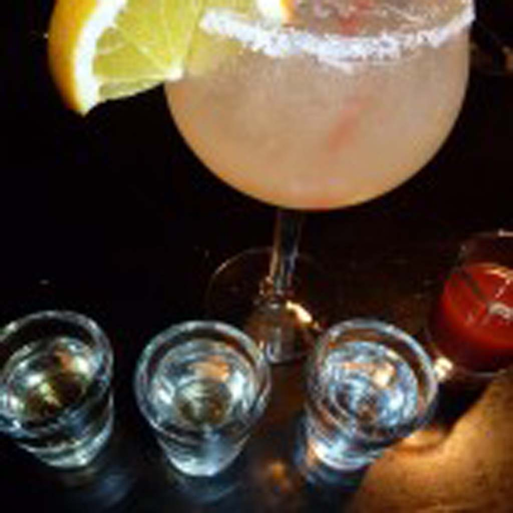 "A margarita like the ""Perfect Cadillac,"" shown above, is a popular mix with tequila.  Tequila tasting should include, right to left: Blanco, Reposata and Anejo.  On the far right, a ""tomato juice chaser."""