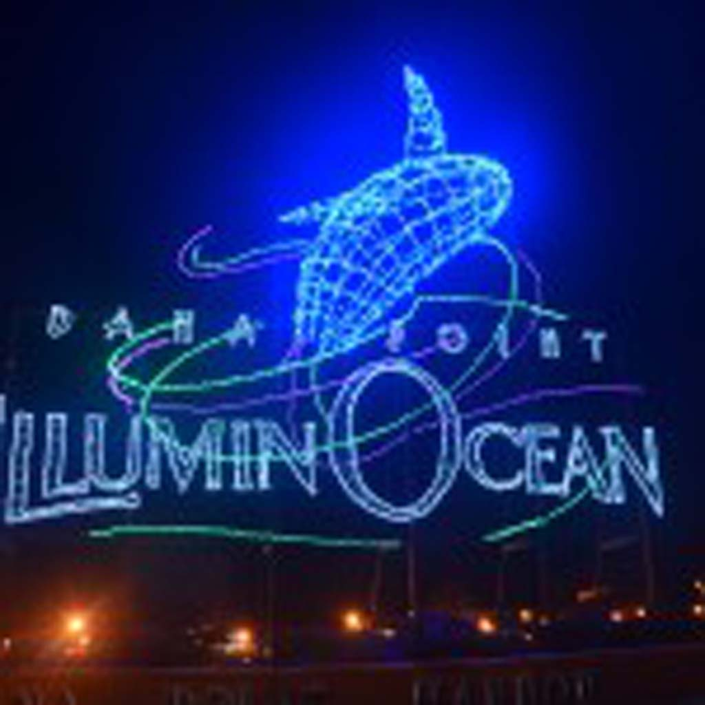 """This large sign at Dana Point Harbor Drive and Golden Lantern Drive welcomes visitors to the """"IlluminOcean – 40 Nights of Holiday Lights"""" event in Dana Point Harbor. The free event runs through Jan 4. (Photo by Jerry Ondash)"""