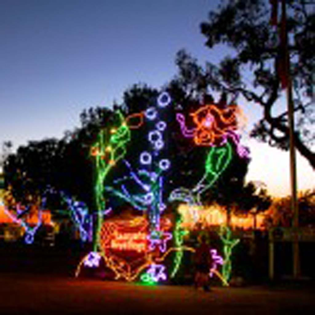 As the sun sets at Dana Point Harbor, light sculptures such as this whimsical mermaid come to life. (Courtesy photo)