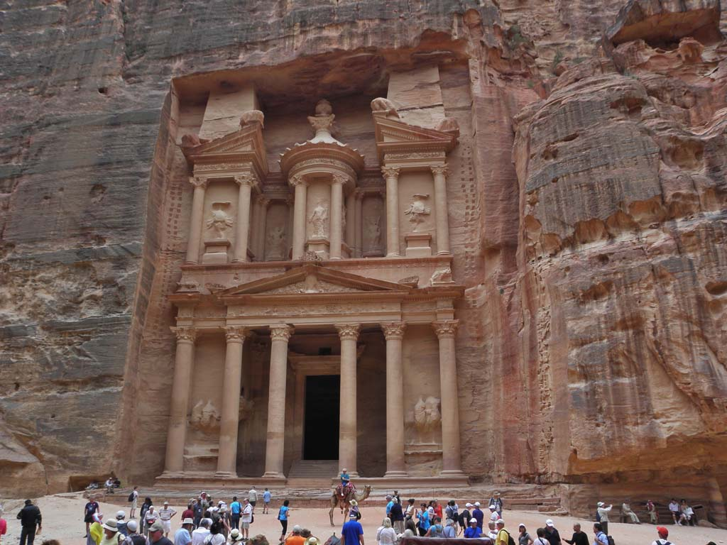 "The Treasury, a part of Petra, is Jordan's most visited attraction and a UNESCO World Heritage Site. It appears suddenly after winding through a narrow canyon for about two-thirds of a mile. Legend holds that Pharaoh stashed his treasure here while chasing the Israelites across the desert. ""Indiana Jones and the Last Crusade"" was filmed here."