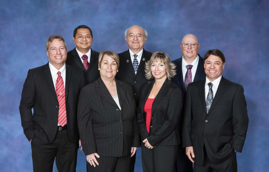 The new board of directors for the Palomar Health District determines the direction of the largest public healthcare district in California. Pictured clockwise from back left, Jeff Griffith, Hans Christian Sison, Jerry Kaufman, Ray McCune, Aeron Wickes, Dara Czerwonka and Linda Greer. Courtesy photo