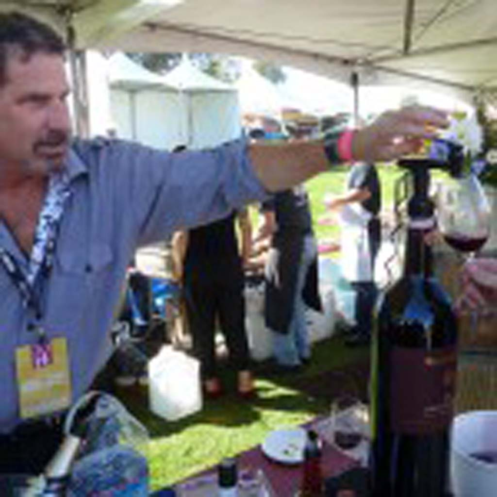 Andrew Pfeffer of Palm Beach Wines offers a taste of one of his Italian Chianti Classicos at the Grand Tasting, a feature of the San Diego Bay Wine & Food Festival. Photo by Frank Mangio