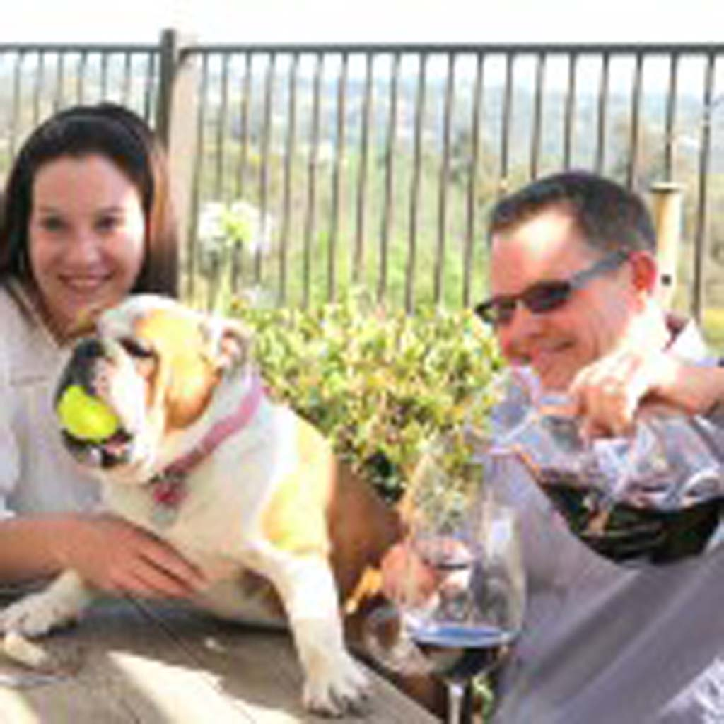 Maureen and Skip Coomber enjoy a glass of their 2010 Private Reserve Rutherford Cabernet with Maggie, their tennis ball-loving bulldog. Photo courtesy Maureen and Skip Coomber
