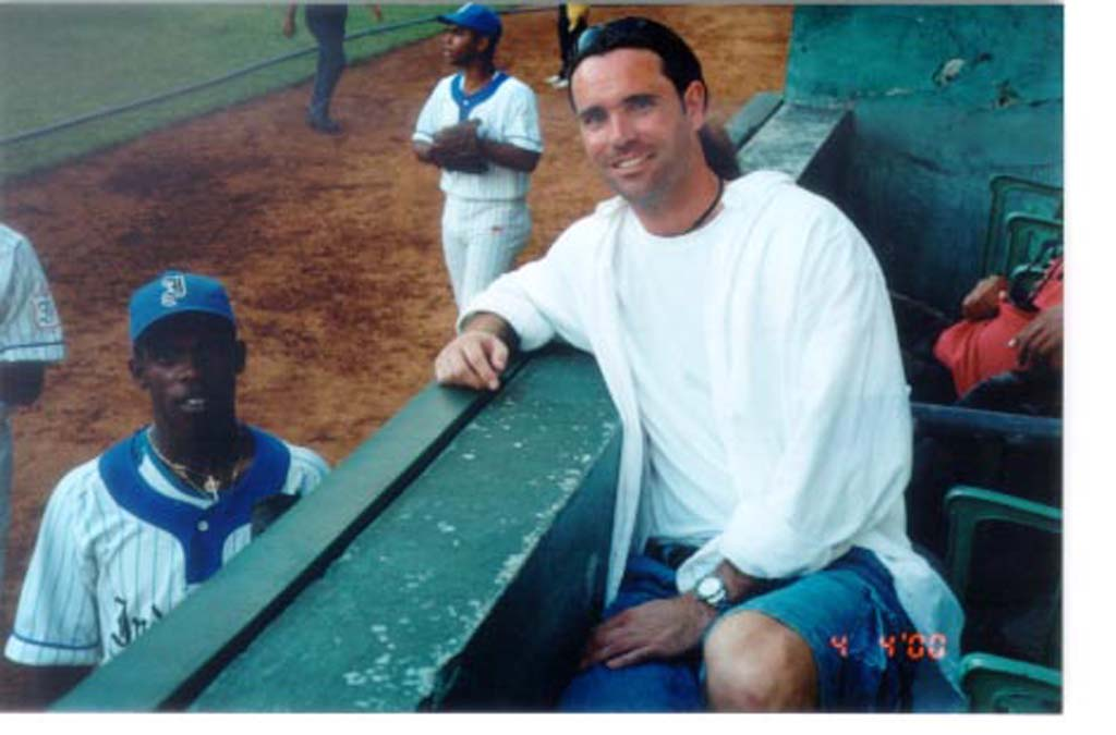 David Ondash of Carlsbad visits with a Cuban baseball player in Havana in 2000. The player wanted news about teammates who had defected to the United States. He said ball players never hear about fellow players after they leave Cuba. Courtesy photos