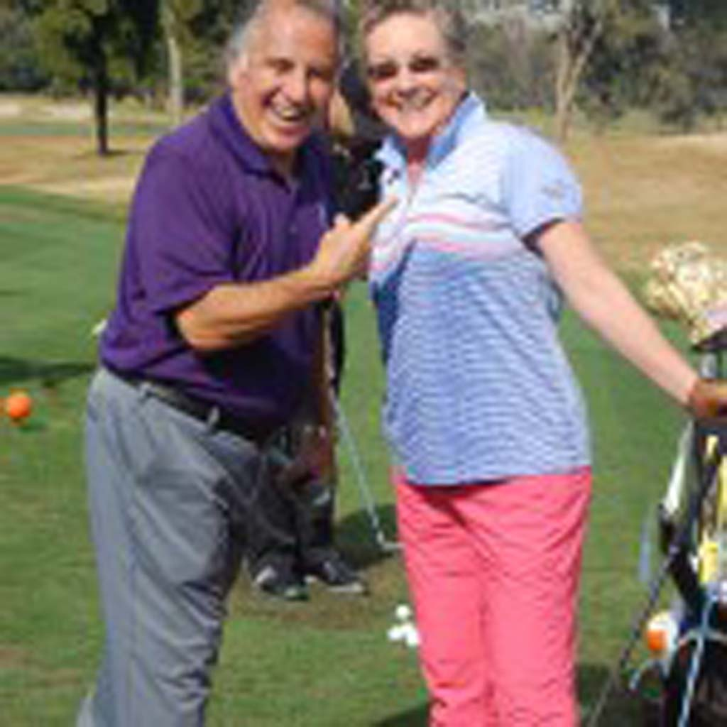 Operation Game On founder Tony Perez celebrates with Nancy Neglia, the first golfer and only woman to sink a hole-in-one during his inaugural 15-Inch Hole-in-One Cup Challenge that will benefit his program that provides golf lessons to combat-injured troops. Photo by Bianca Kaplanek