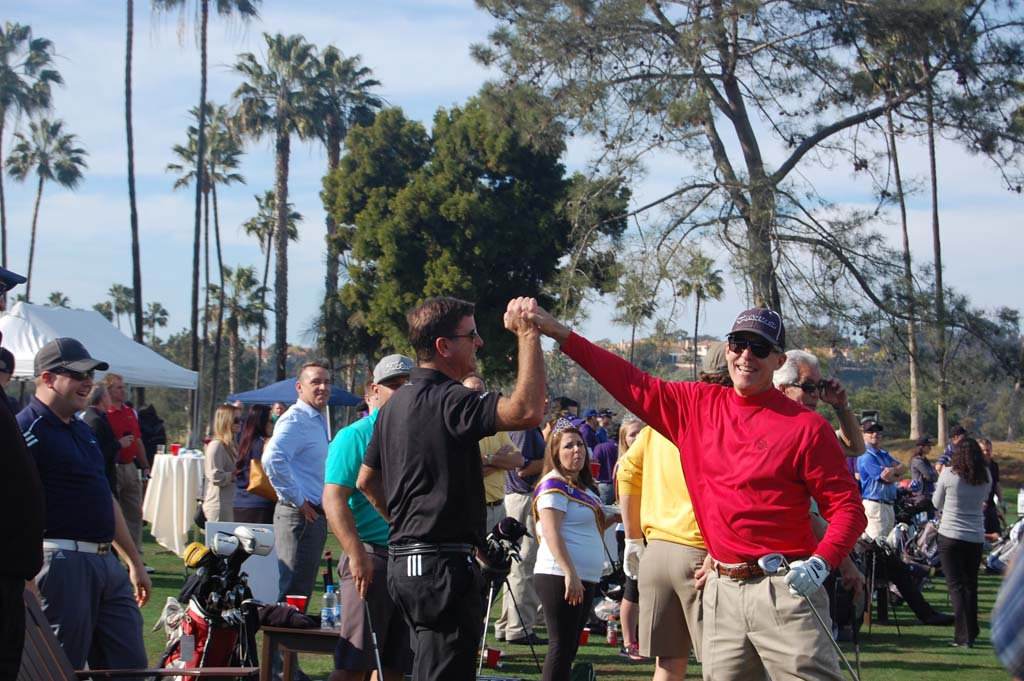 Jeff Gearhart, right, is all smiles and high-fives after sinking the first of this two aces for the day. Photo by Bianca Kaplanek