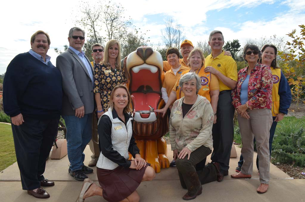 Encinitas city officials with the Encinitas Lions Club and San Diego County Supervisor Dave Roberts, third from right, pose at the Lions water fountain. Photo by Tony Cagala