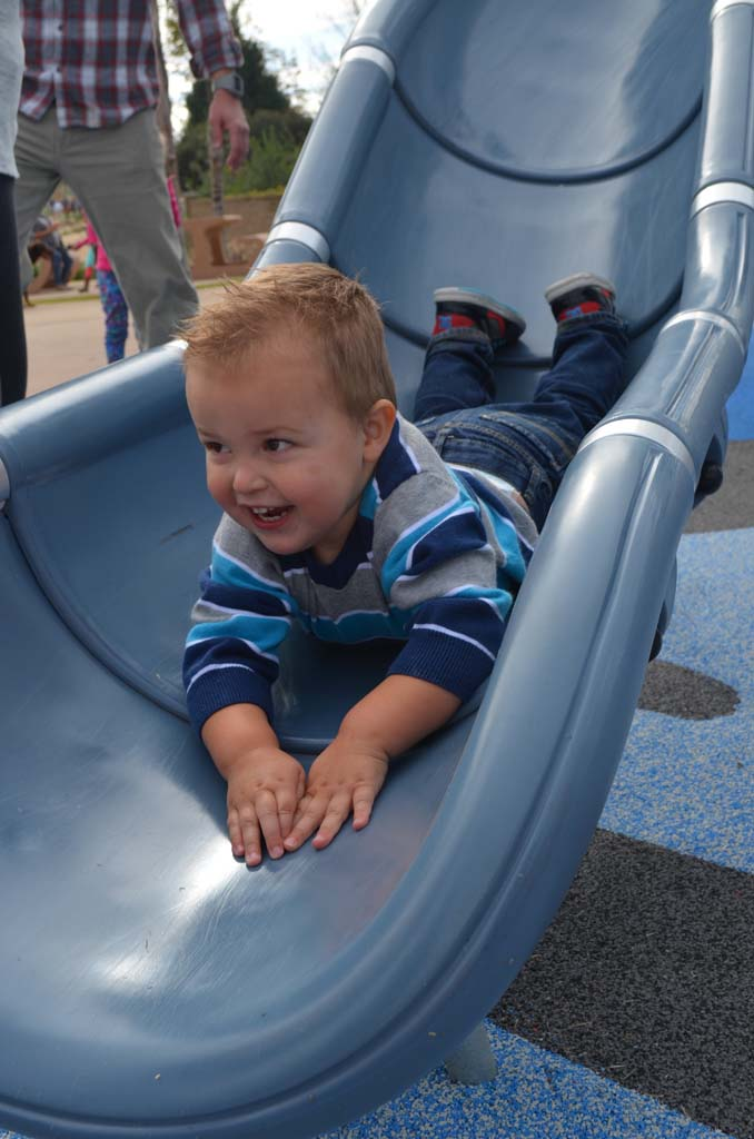 Duke Burgon, 2, goes head first down the slide. Photo by Tony Cagala