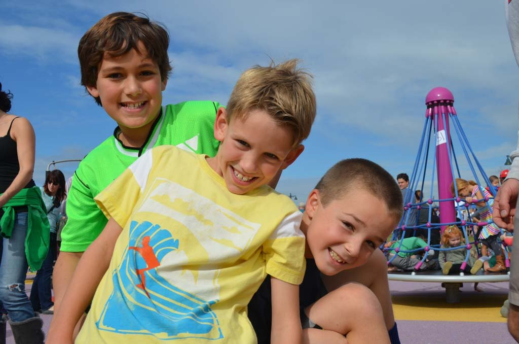 From left: Luke Palmer, 9, Billy Backlin, 8, and James Blue, 8, enjoy the new park. Photo by Tony Cagala