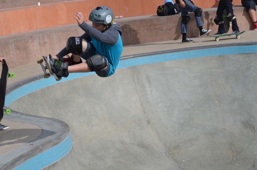 A skater pulls off a maneuver at the skate park's bowl. Photo by Tony Cagala
