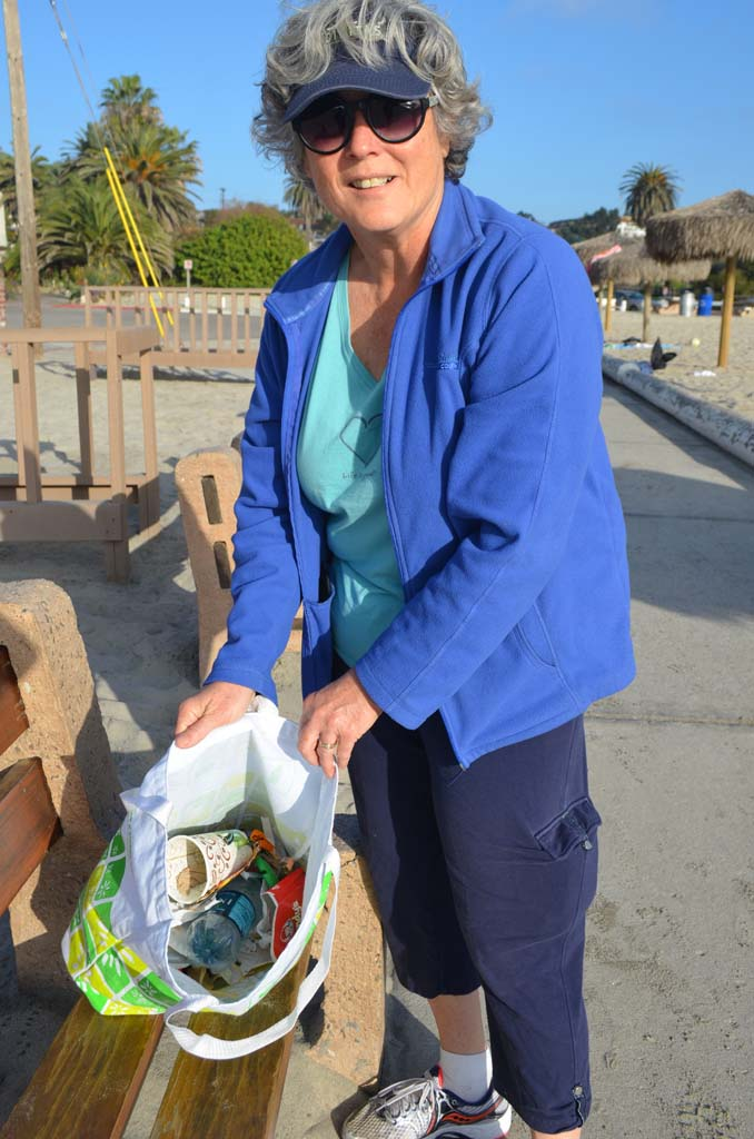 Encinitas Councilwoman Lisa Shaffer shows what 15 minutes of picking up trash at Moonlight Beach yields. Photo by Tony Cagala