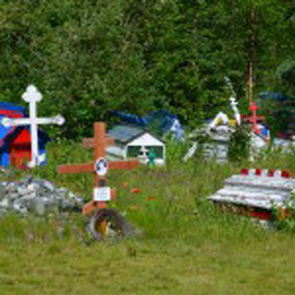 """After the Dena'ina Athabascan Indians of Eklutna, Alaska, converted to Russian Orthodoxy in the mid-1800s, they were no longer allowed to cremate the bodies of their dead. Instead, they built """"spirit houses"""" over the graves so the spirits of the dead had someplace to reside before making their final journey. Each color represents a different family."""