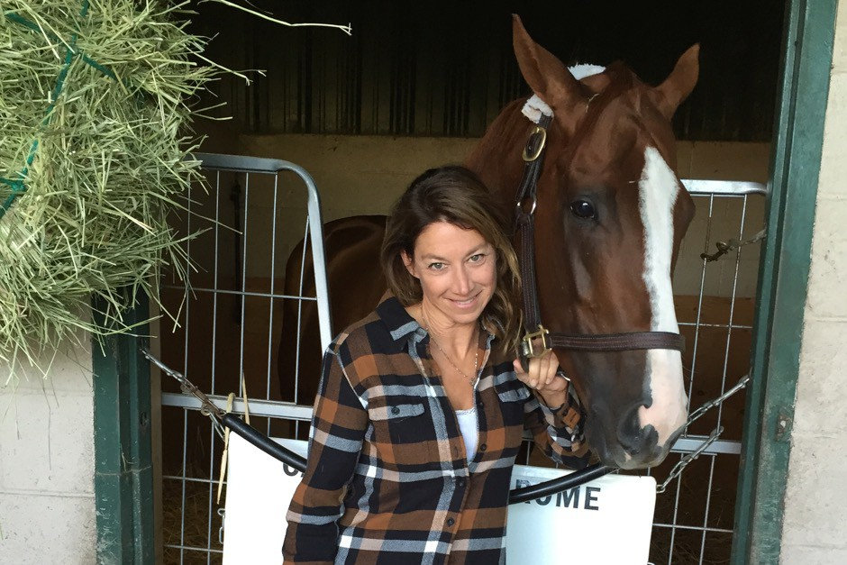 Paula Besset, a Torrey Pines High School alum and Encinitas resident is helping train California Chrome, a candidate for horse of the year. Courtesy photo