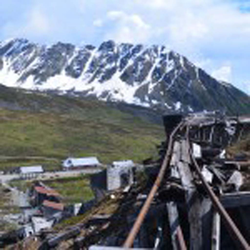 Disintegrating track that once carried ore out of the earth still stands at the Independence Mine in the Mat-Su Valley north of Anchorage. The mine closed in 1943 after the federal government declared gold mining a non-essential industry for wartime. Postwar, the price of gold was fixed at $35 an ounce, so mining was not profitable.