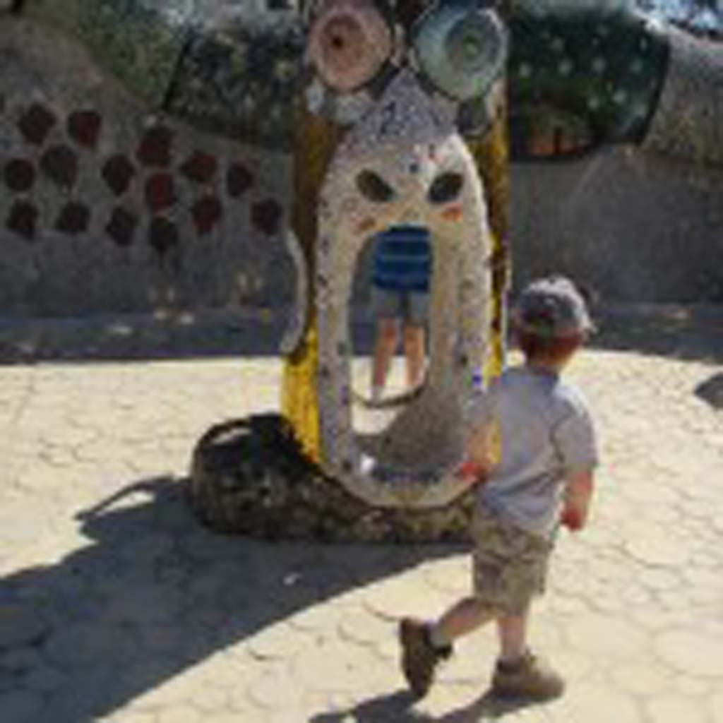 The foot of one of the totem poles offers children the opportunity to interact with the art. Photo by Ellen Wright