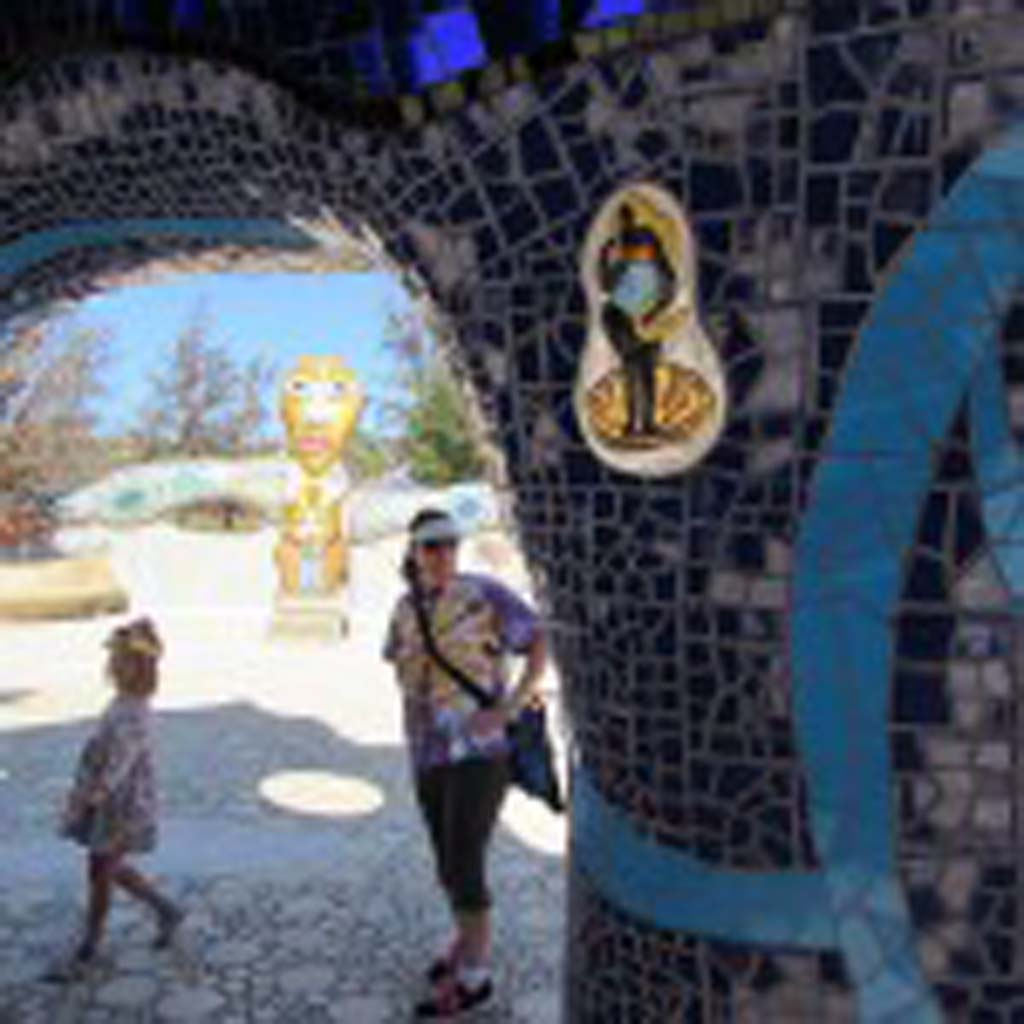 """Underneath """"The Eagle"""" is a rich blue celestial mosaic. Visitors explored the under belly of """"The Eagle"""" and were given a quick reprieve from the heat. Photo by Ellen Wright"""