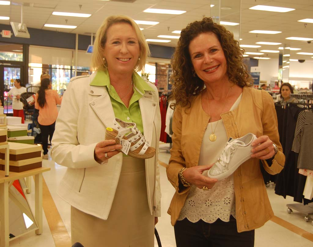 Mayor Lesa Heebner, right, and Councilwoman Ginger Marshall display a few of their favorites. Photo by Bianca Kaplanek