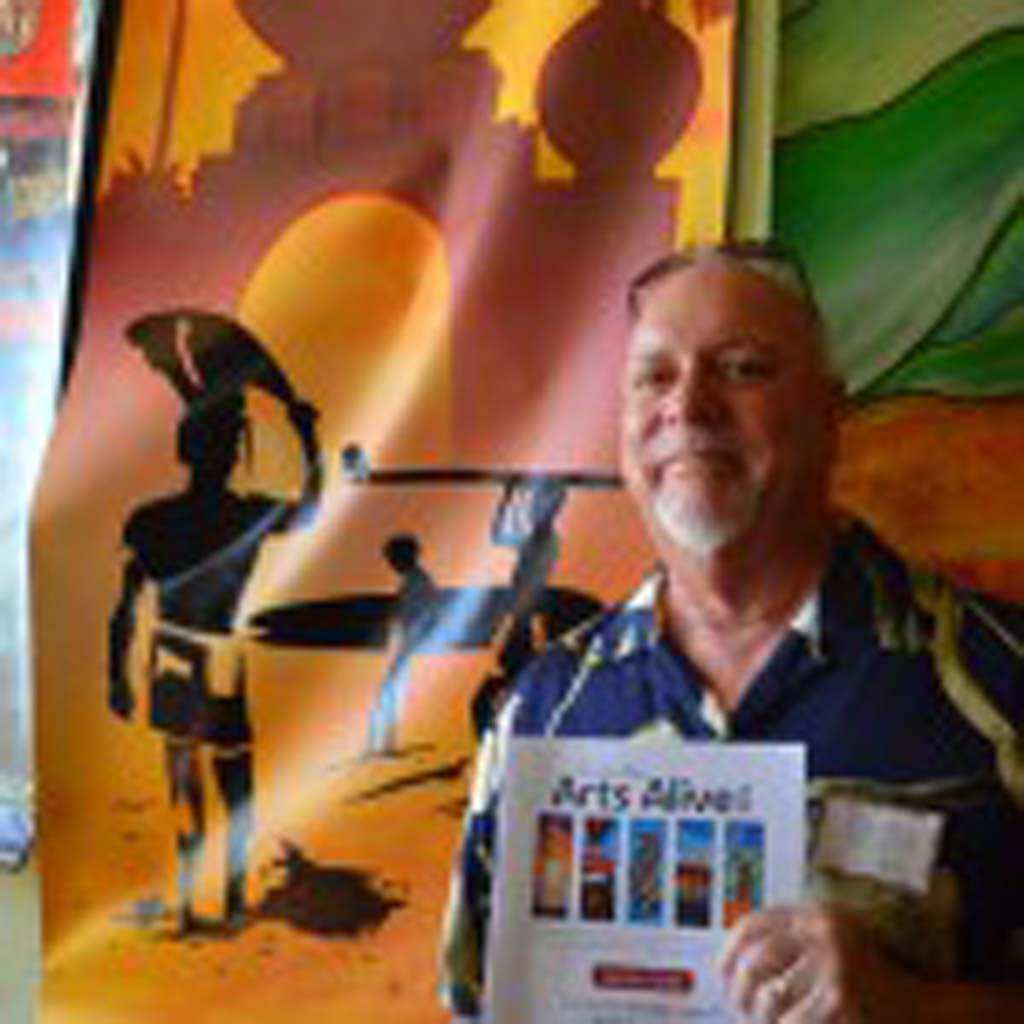"Artist Don Doerfler stands next to his banner ""Endless Encinitas,"" on Saturday. Photo by Tony Cagala"