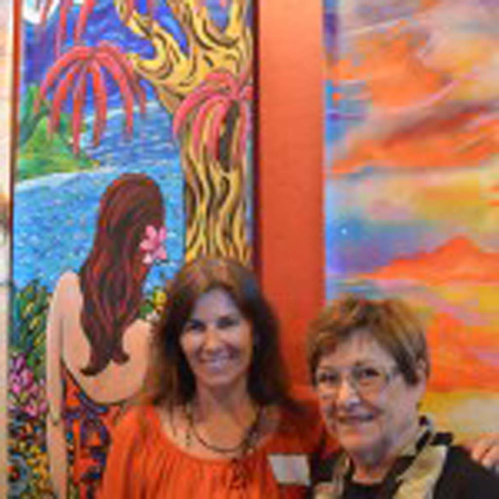 "Artist Christina Zeller, left, unveils her art banner ""Me Ke Aloha Pumehana,"" along with her mother Marlis Zeller. Photo by Tony Cagala"