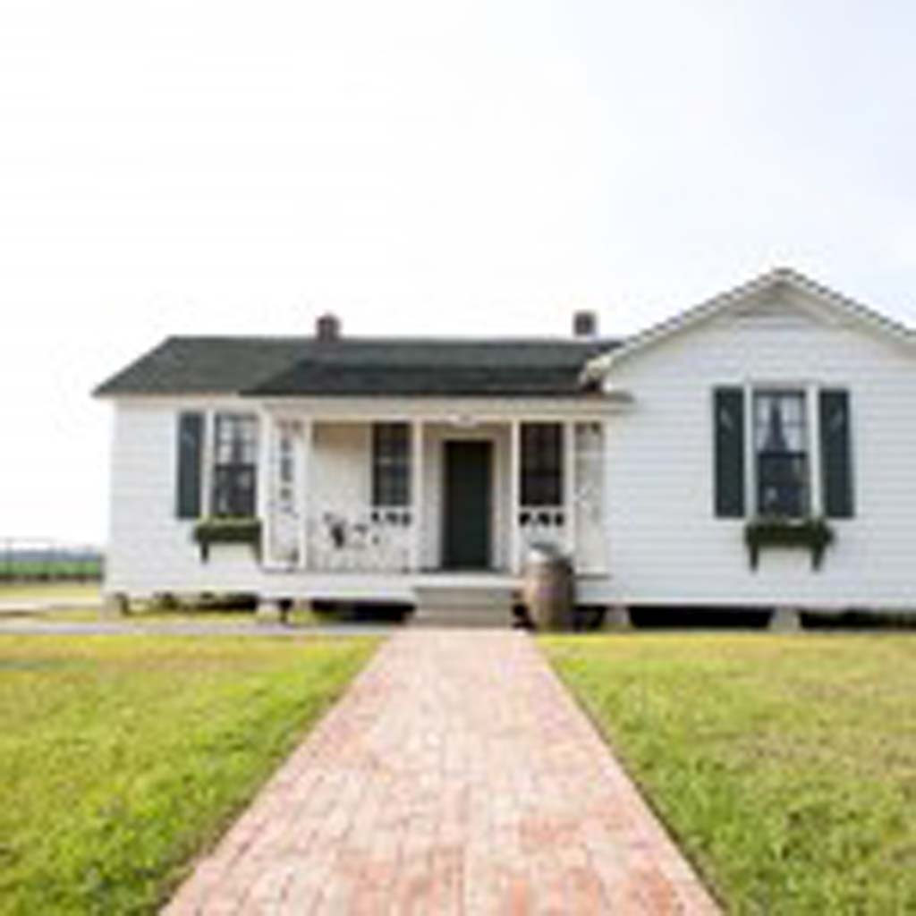 """ohnny Cash's father, Ray, brought his family to Dyess, Ark., in 1935 when President Roosevelt's administration created Dyess Colony in Mississippi County, an experiment in American socialism. With no money down, the Cash family was given 20 acres of fertile bottomland and this five-room house, which was seen in the motion picture """"I Walk the Line."""" The home is listed by Lonely Planet publishers as one of the best new destinations to open in 2015. (Andrew Ferguson, Arkansas State University Communications)"""