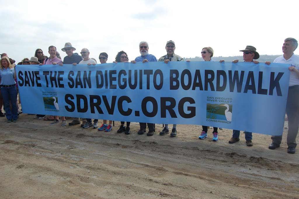 Supporters walk the planks to save the boardwalk
