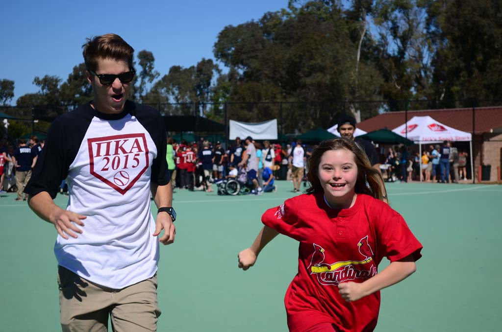 Korey McKeown, left, and Jessica Meeks take part in an impromptu race in the outfield of the Engel Family Field. Photo by Tony Cagala