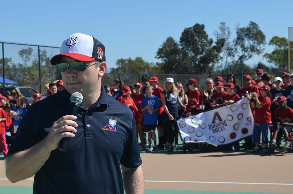 Miracle League of San Diego President Kenny Battenbauer addresses the teams and families during the 2015 spring Opening Day Ceremonies on Saturday. Photo by Tony Cagala