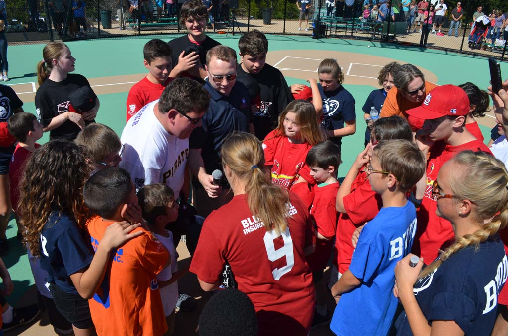Players, with Miracle League of San Diego President Kenny Blattenbauer sing the National Anthem. Photo by Tony Cagala