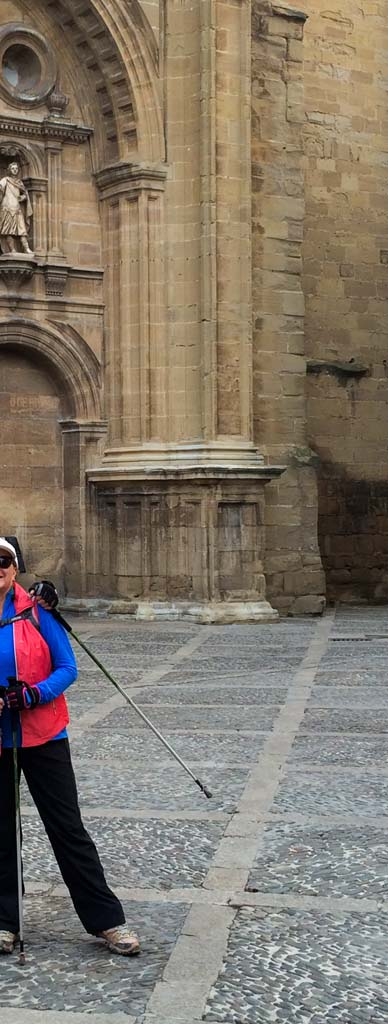 Tim and Peggy O'Shea pause in front of the cathedral in Santo Domingo de Calzada, almost halfway between their starting point in southwestern France and the end-point in Santiago in northwest Spain. The route has been traveled by millions of pilgrims since the Middle Ages.